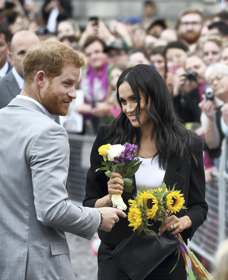 DUBLIN, IRELAND - JULY 11: Prince Harry, Duke of Sussex and Meghan, Duchess of Sussex visit Trinity College on the second day of their official two day royal visit to Ireland on July 11, 2018 in Dublin, Ireland. It is the royal couple's first foreign trip together since they were married earlier this year. (Photo by Charles McQuillan/Getty Images)