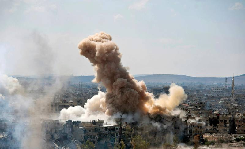 """FILE - In this file photo released on Sunday, April 22, 2018 by the Syrian official news agency SANA, smoke rises after Syrian government airstrikes and shelling hit in Hajar al-Aswad neighborhood held by Islamic State militants, southern Damascus, Syria. Syria's military said Monday, May 21, 2018, that it has liberated the last neighborhoods in southern Damascus held by the Islamic State and has declared the Syrian capital and its surroundings """"completely safe"""" and free of any militant presence. (SANA via AP, File)"""