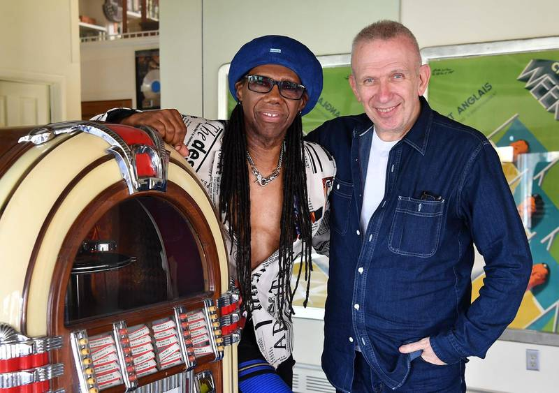 Fashion Designer Jean Paul Gaultier and Record Producer Nile Rodgers pose for a picture on May 3, 2018 in Westport, Connecticut. Deciding how to tell his story as one of fashion's edgiest designers, Jean Paul Gaultier knew there had to be music. And he knew it had to come from Nile Rodgers. The designer who has brought playful and provocative clothes to the world's runways for four decades is turning the focus to himself with an autobiographical show to open on October 2 in Paris. / AFP PHOTO / ANGELA WEISS / With AFP story bu Shaun TANDON:  Freak out: Telling a fashion life, Gaultier taps Nile Rodgers