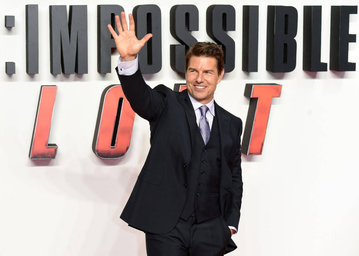 (FILES) In this file photo taken on July 13, 2018 US actor Tom Cruise arrives for the UK premiere of the film Mission: Impossible - Fallout in London. Far from being wiped out by the coronavirus pandemic, Britain's film and television industry is enjoying a blockbuster run thanks in large part to a surge in online streaming. Attracting global production teams to spectacular landscapes, gothic castles and state-of-the-art studios in the UK, the nation's film industry has enjoyed big growth in recent years -- also thanks to tax breaks.   / AFP / Anthony HARVEY
