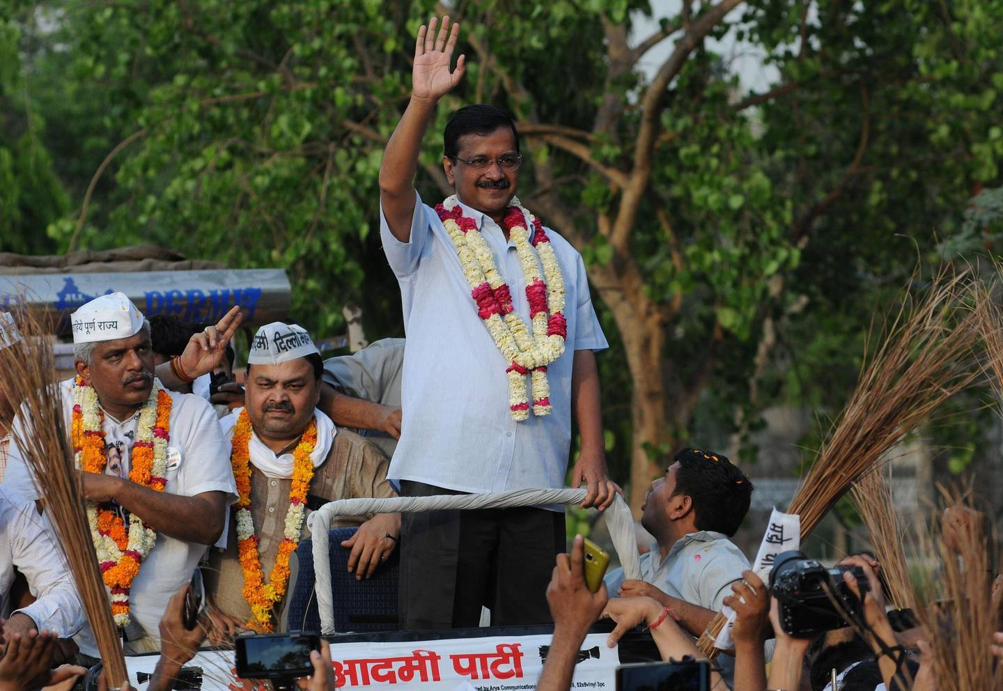 epa07540480 Aam Aadmi Party chief and Delhi Chief minister Arvind Kejriwal (C), waves towards supporters during an election campaign road show in New Delhi, India, 01 May 2019. Voting for the Parliamentary elections in Delhi will be held in a single phase on 12 May 2019. The parliamentary elections, which began on 11 April 2019, are to be conducted in seven phases throughout India and result will be announced on 23 May.  EPA/STR