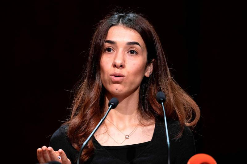 Laureate of the Nobel Peace Prize and Iraqi Yazidi Nadia Murad gives a speech during a commemoration ceremony in Stuttgart, southern Germany, on August 3, 2019. The Central Yazidi Council in Germany commemorates the 5th anniversary of the genocide of the Yazidi in August 2014 when fighters of the Islamic State (IS) killed thousands of Yazidi in Iraq. / AFP / THOMAS KIENZLE