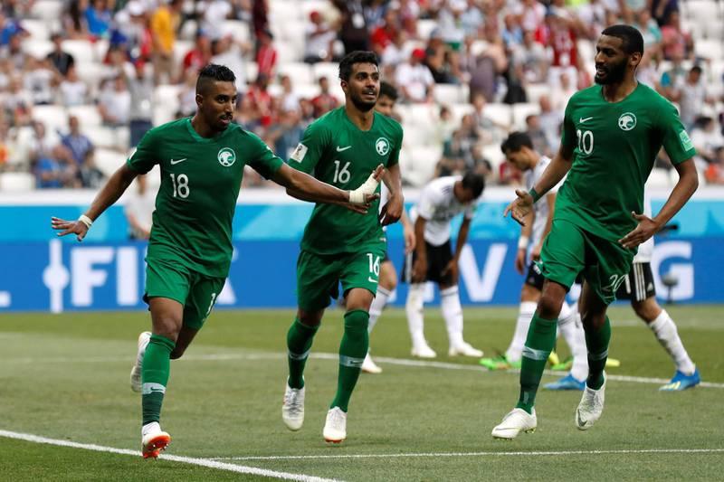 Soccer Football - World Cup - Group A - Saudi Arabia vs Egypt - Volgograd Arena, Volgograd, Russia - June 25, 2018   Saudi Arabia's Salem Al-Dawsari celebrates with Housain Al-Mogahwi and Muhannad Assiri after scoring their second goal    REUTERS/Damir Sagolj