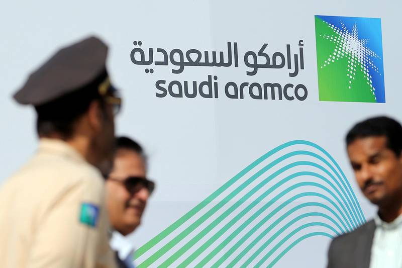 FILE PHOTO: The logo of Aramco is seen as security personnel stand before the start of a press conference by Aramco at the Plaza Conference Center in Dhahran, Saudi Arabia November 3, 2019. REUTERS/Hamad I Mohammed/File Photo