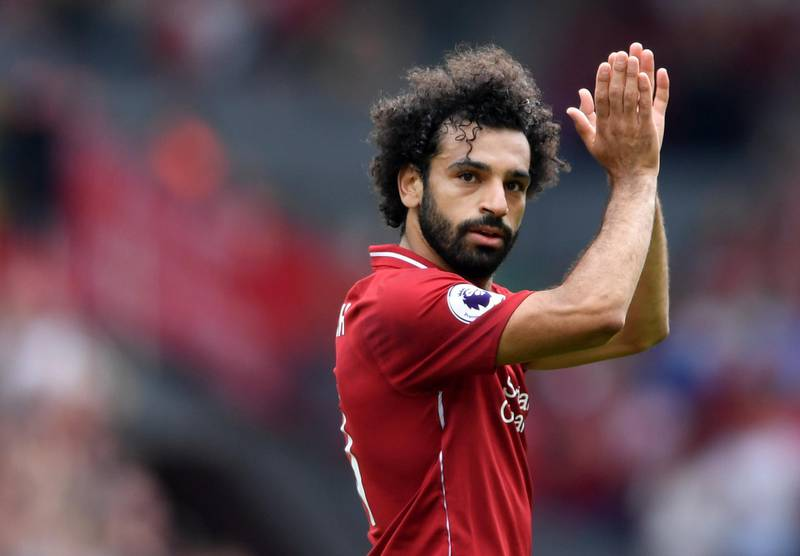 LIVERPOOL, ENGLAND - AUGUST 12:  Mohamed Salah of Liverpool applauds fans during the Premier League match between Liverpool FC and West Ham United at Anfield on August 12, 2018 in Liverpool, United Kingdom.  (Photo by Laurence Griffiths/Getty Images)