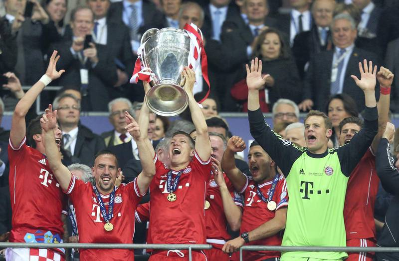 LONDON, ENGLAND - MAY 25:  Bastian Schweinsteiger of Bayern Muenchen lifts the trophy in celebration alongside team mates after victory in the UEFA Champions League final match between Borussia Dortmund and FC Bayern Muenchen at Wembley Stadium on May 25, 2013 in London, United Kingdom.  (Photo by Alex Grimm/Getty Images)