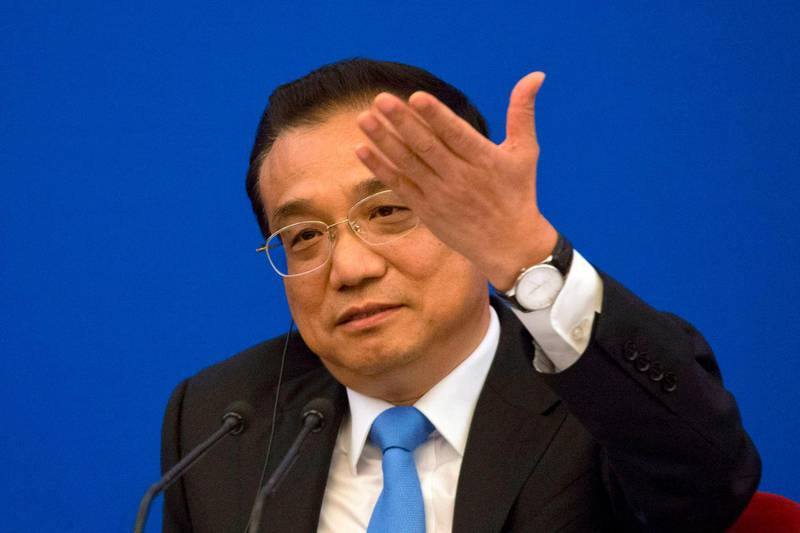 """China's Premier Li Keqiang speaks during the China-EU Business Roundtable at the Great Hall of the People in Beijing on July 16, 2018. The European Union on July 16 called on the United States, China and Russia to work together to cool worsening global trade tensions, warning that they could spiral into violent """"conflict and chaos."""" / AFP / POOL / Ng Han Guan"""