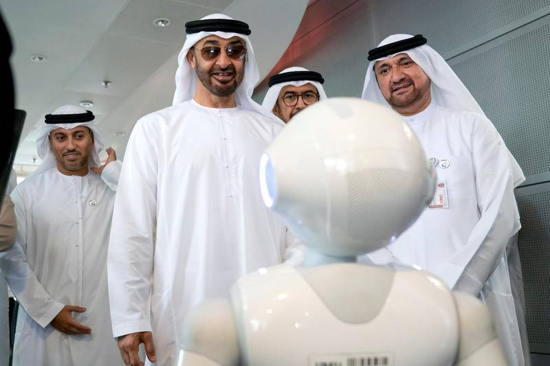 AL AIN, ABU DHABI, UNITED ARAB EMIRATES - February 07, 2019: HH Sheikh Mohamed bin Zayed Al Nahyan, Crown Prince of Abu Dhabi and Deputy Supreme Commander of the UAE Armed Forces (C), looks at a robots, during a visit to the United Arab Emirates University. Seen with Mohamed Abdulla Al Baili, Vice Chancellor of the United Arab Emirates UAE University (UAEU) (R) and HE Dr Ahmed Abdullah Humaid Belhoul Al Falasi, UAE Minister of State for Higher Education (L). ( Ryan Carter for the Ministry of Presidential Affairs ) ---