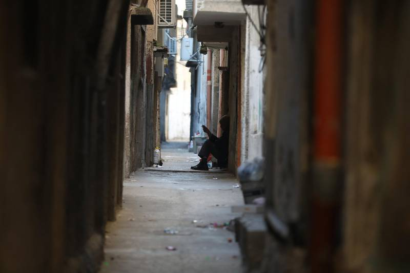 epa06426184 A Palestinain refugee sits outside his home in a narrow street of the Balata refugee camp near the West Bank city of Nablus, 09 January 2018. Media report that the US President Donald J. Trump had vowed to freeze about 125 million US dollar of aid for the United Nations Relief and Works Agency (UNRWA) for Palestine Refugees. The US ambassador to the United Nations (UN), Nikki Haley, was quoted as saying that Trump did not want to add or stop funding until the Palestinians were agreeing to return to the negotiation table. Following the 1948 Arab-Israeli conflict, UNRWA was established by the United Nations General Assembly Resolution 302 (IV) in 1949 to carry out direct relief and works programs for Palestine refugees from May 1950 on. Until today, some five million Palestine refugees are eligible for their services, UNRWA says on their website.  EPA/ALAA BADARNEH