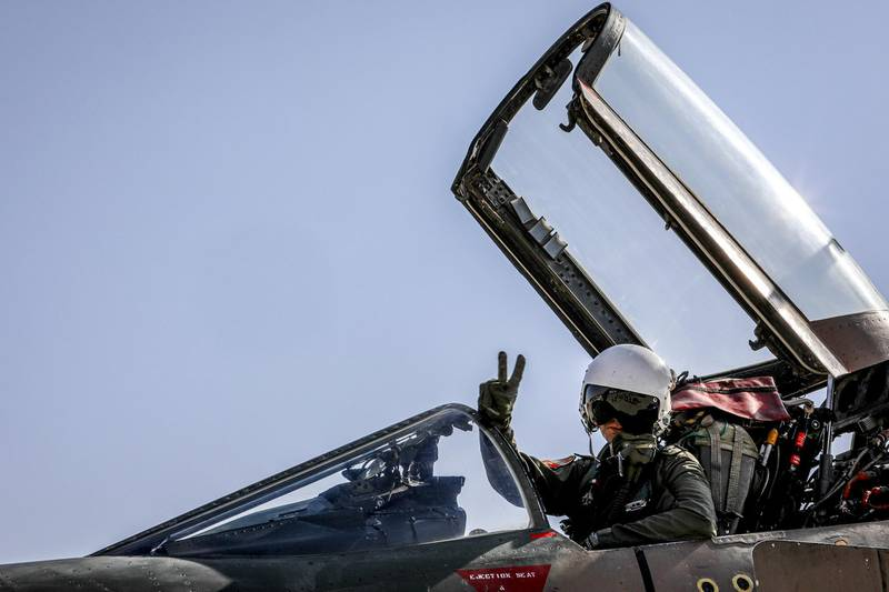 """A handout picture made available by the Iranian Army office on November 2, 2020 shows a pilot of the Islamic Republic of Iran Air Force flashing the victory gesture from the open cockpit of an F-4E Phantom II fighter-bomber aircraft during an aerial exercise in Isfahan in central Iran.  - === RESTRICTED TO EDITORIAL USE - MANDATORY CREDIT """"AFP PHOTO / HO / Iranian Army office"""" - NO MARKETING NO ADVERTISING CAMPAIGNS - DISTRIBUTED AS A SERVICE TO CLIENTS ===  / AFP / Iranian Army office / - / === RESTRICTED TO EDITORIAL USE - MANDATORY CREDIT """"AFP PHOTO / HO / Iranian Army office"""" - NO MARKETING NO ADVERTISING CAMPAIGNS - DISTRIBUTED AS A SERVICE TO CLIENTS ==="""