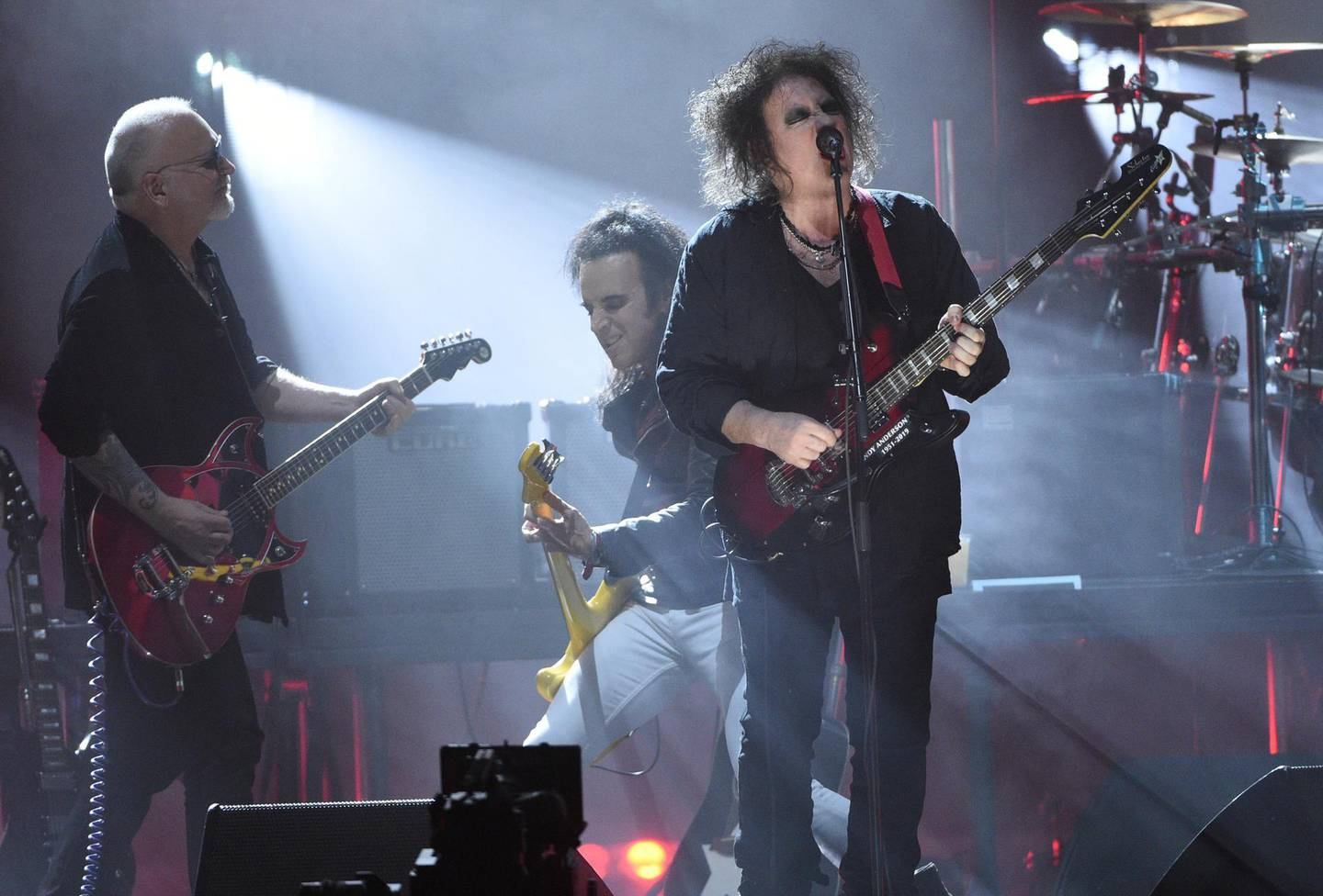 Inductees Reeves Gabrels, from left, Simon Gallup and Robert Smith, of The Cure, perform at the Rock & Roll Hall of Fame induction ceremony at the Barclays Center on Friday, March 29, 2019, in New York. (Photo by Evan Agostini/Invision/AP)