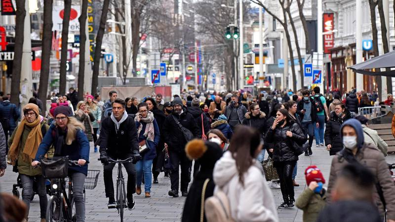 VIENNA, AUSTRIA - NOVEMBER 16: People walk along the popular Mariahilferstrasse pedestrian shopping zone the day before a strict nationwide lockdown is to go into effect on November 16, 2020 in Vienna, Austria. Starting tomorrow shops and businesses must close, schools may only operate remotely and people must stay indoors at home except for the most necessary outings. Additionally health authorities plan to soon launch mass Covid testing for the entire country. (Photo by Thomas Kronsteiner/Getty Images)