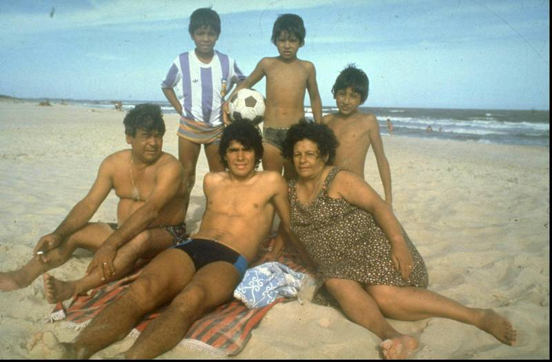 1970:  A young Diego Maradona (centre) of Argentina relaxing with his family on a beach. \ Mandatory Credit: Allsport UK /Allsport