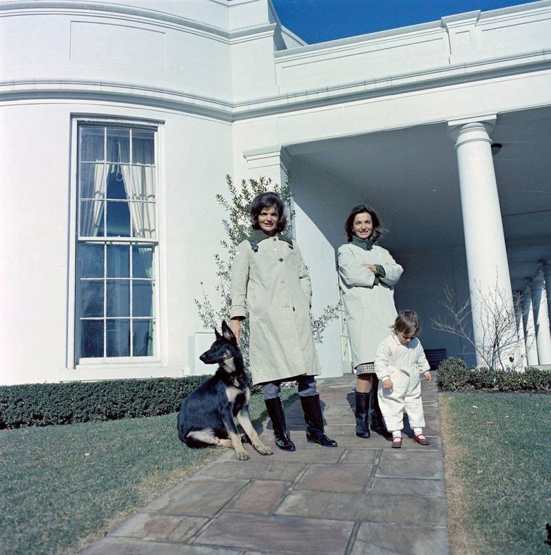 FILE PHOTO --  First Lady Jacqueline Kennedy (L) stands with her sister, Princess Lee Radziwill of Poland, and niece, Anna Christina Radziwill, on the walkway outside the Oval Office with the Kennedy family dog Clipper at the White House in Washington, D.C., January 15, 1963.   Courtesy Cecil Stoughton/JFK Library/Handout via REUTERS  ATTENTION EDITORS - THIS IMAGE WAS PROVIDED BY A THIRD PARTY.
