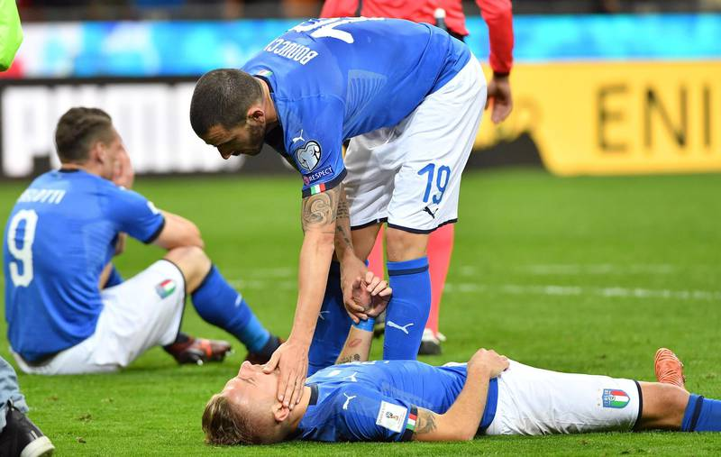 epa06327562 Italy's defender Leonardo Bonucci and teammate forward Ciro Immobile show their dejection at the end of the FIFA World Cup 2018 qualification playoff second leg soccer match between Italy and Sweden at the Giuseppe Meazza stadium in Milan, Italy, 13 November 2017. Sweden won 1-0 on aggregate.  EPA/DANIEL DAL ZENNARO
