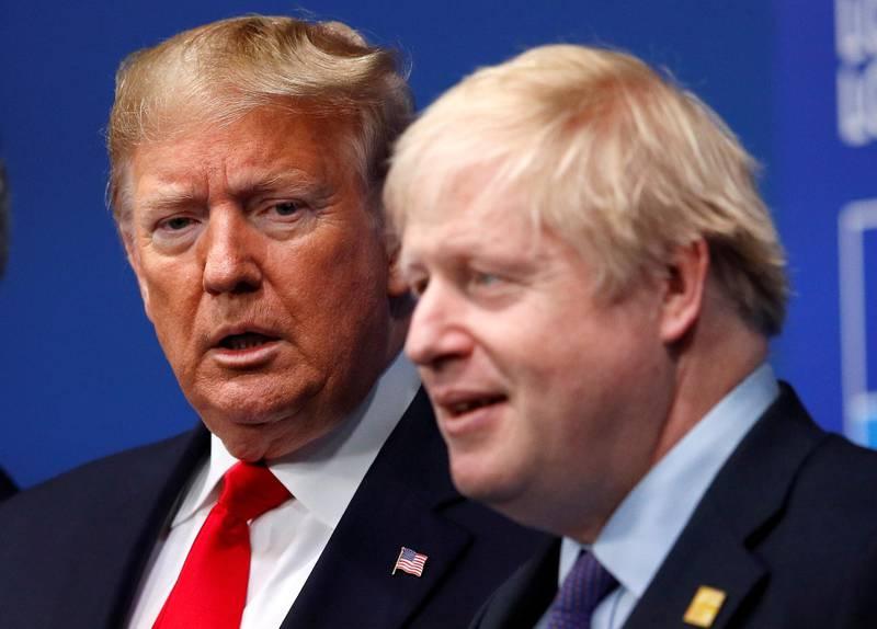 FILE PHOTO: Britain's Prime Minister Boris Johnson welcomes U.S. President Donald Trump at the NATO leaders summit in Watford, Britain December 4, 2019. REUTERS/Peter Nicholls/Pool/File Photo