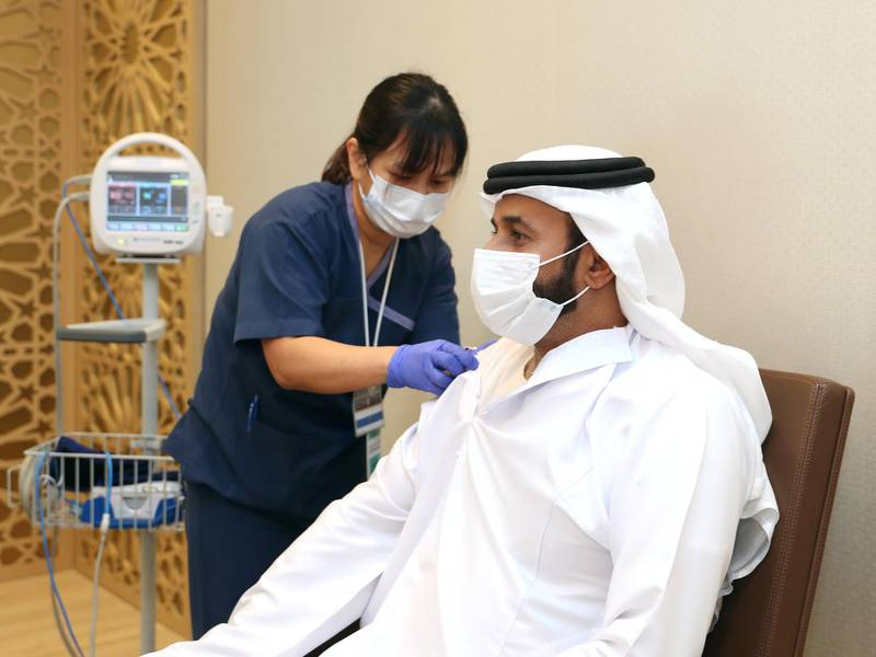 The director general of the National Emergency, Crisis and Disasters Management Authority, Obaid Al Shamsi, taking the vaccine. Wam