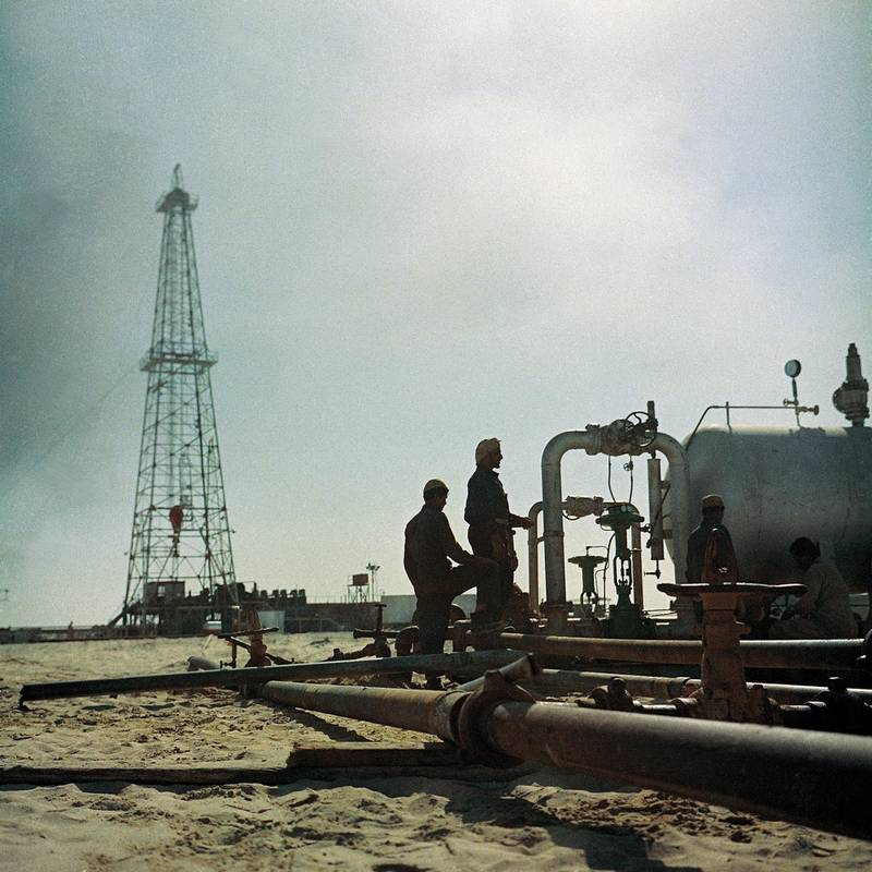 Workers at the Murban 2 well in 1958. Two years later the Murban 3 well would find commercial quantities of crude oil     1956. Rigs general. UAE Coast. Abu Dhabi crew working on Murban 2. Courtesy: Adnoc *** Local Caption *** 1961/12
