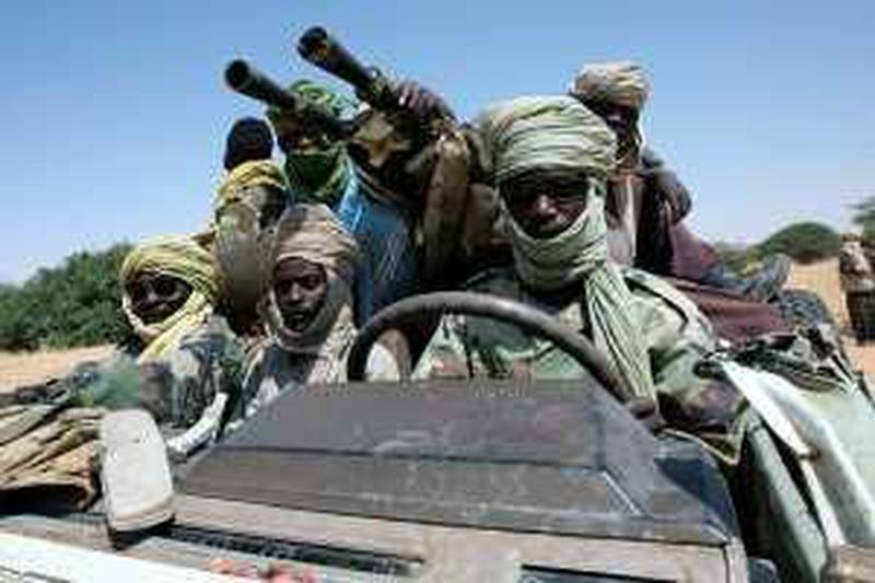 """TO GO WITH AFP STORY BY GUILLAUME LAVALLEE<br />(FILES) A picture taken on October 17, 2007 shows fighters of the Sudanese Justice and Equality Movement (JEM) driving their battlewagon through an area on the Sudan-Chad border in northwest Darfur. The six-year Darfur conflict is almost over, Sudan's new pointman for the thorny dossier, Ghazi Salaheddin, said on June 11, 2009, inviting exiled rebel leader Abdel Wahed Mohammed Nur to seize a """"historic opportunity"""" for peace. AFP PHOTO/AMIS/STUART PRICE *** Local Caption ***  158664-01-10.jpg"""