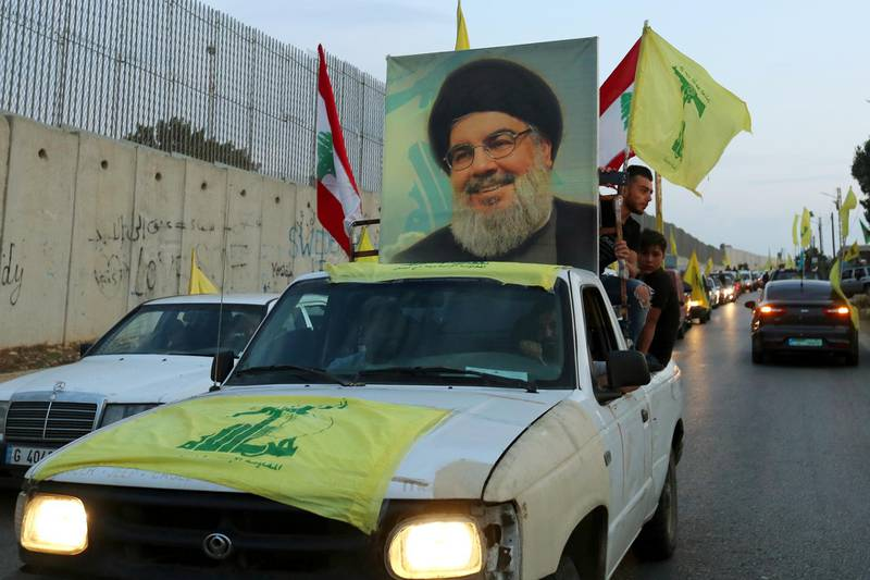 FILE PHOTO: Supporters of Lebanon's Hezbollah leader, Sayyed Hassan Nasrallah, ride in a vehicle decorated with Hezbollah and Lebanese flags and a picture of him, as part of a convoy in the southern village of Kfar Kila, Lebanon October 25, 2019. REUTERS/Aziz Taher/File Photo
