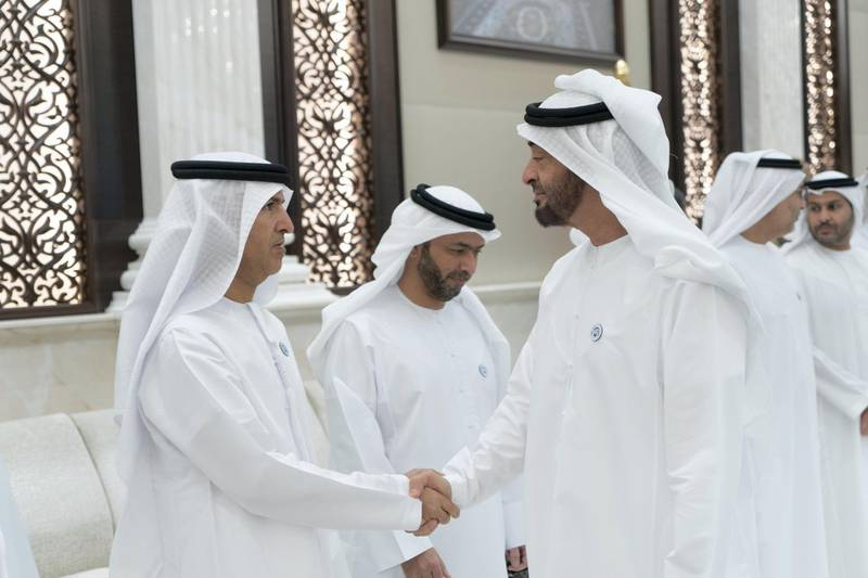 ABU DHABI, UNITED ARAB EMIRATES - May 22, 2018: HH Sheikh Mohamed bin Zayed Al Nahyan, Crown Prince of Abu Dhabi and Deputy Supreme Commander of the UAE Armed Forces (R) greets HE Dr Mugheer Al Khaili, Chairman of the Department of Community Development and Abu Dhabi Executive Council Member (L), during an iftar reception at Al Bateen Palace. Seen with HE Hamad Mohamed Al Hurr Al Suwaidi (2nd L). ( Rashed Al Mansoori / Crown Prince Court - Abu Dhabi ) ---