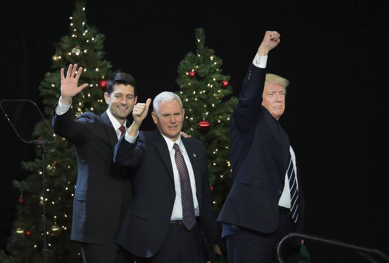 WEST ALLIS, WI - DECEMBER 13: Paul Ryan (L), speaker of the U.S. House of Representatives, Vice President-Elect Mike Pence (C), and President-Elect Donald Trump leave the stage after speaking to supporters at a Thank You Tour 2016 rally on December 13, 2016 in West Allis, Wisconsin. Trump and Pence have been holding the rallies in several states recently to thank voters for electing them.   Scott Olson/Getty Images/AFP