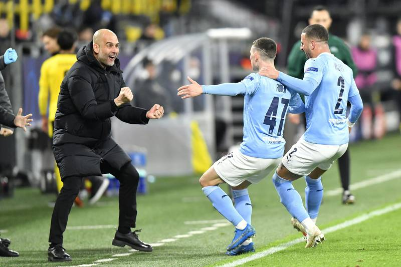 File photo dated 14-04-2021 of Manchester City manager Pep Guardiola celebrates with goal scorer Phil Foden and Kyle Walker (right) after their second goal during the UEFA Champions League, quarter final, second leg match at Signal Iduna Park in Dortmund, Germany. Issue date: Wednesday May 26, 2021. PA Photo. We take a look at Manchester City's route to the Champions League final as they prepare to face Chelsea on May 29th. See PA Story SOCCER Champions League Man City Route. Photo credit should read: PA Wire via DPA/PA Wire
