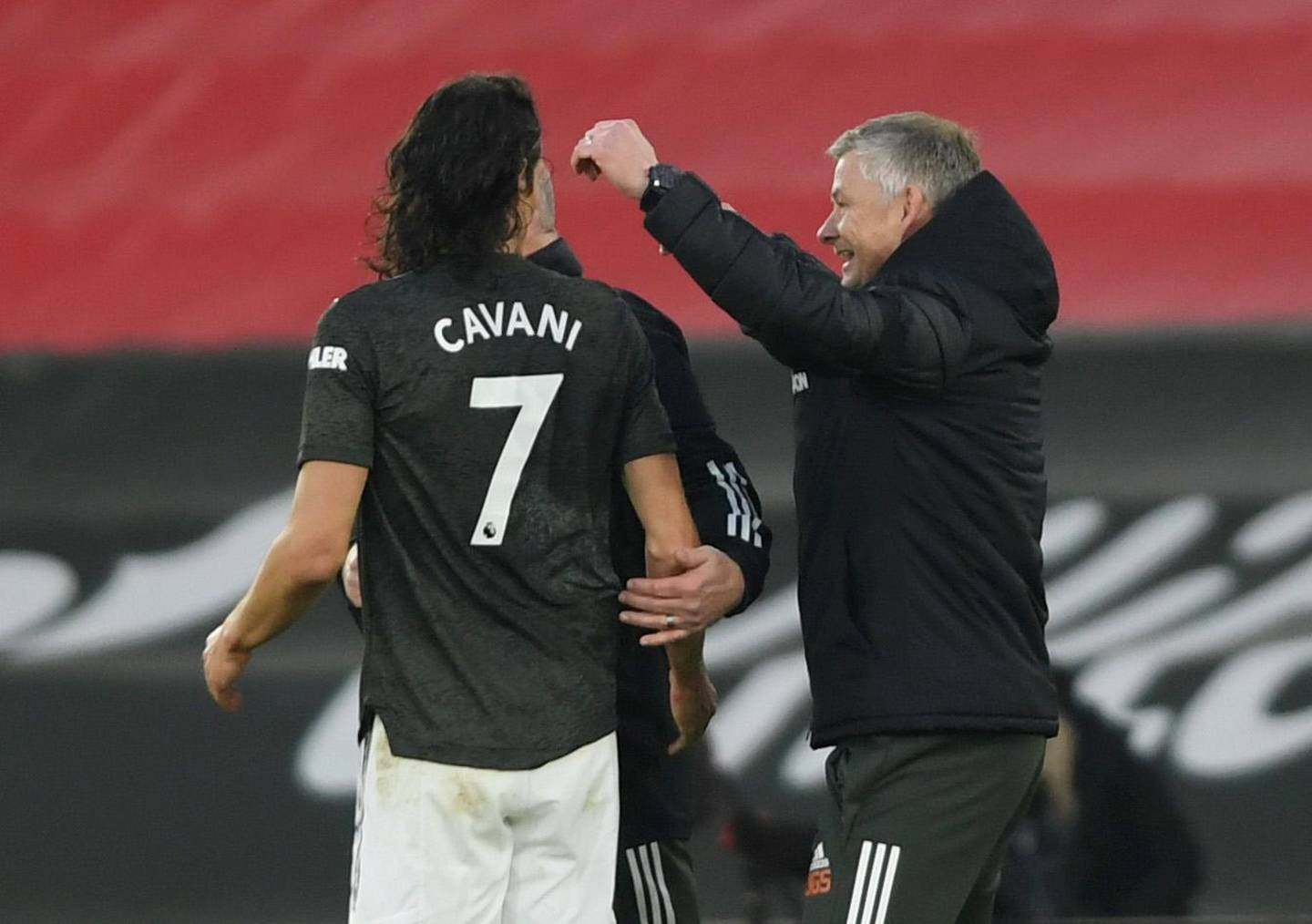 Soccer Football - Premier League - Southampton v Manchester United - St Mary's Stadium, Southampton, Britain - November 29, 2020 Manchester United's Edinson Cavani celebrates with manager Ole Gunnar Solskjaer Pool via REUTERS/Mike Hewitt EDITORIAL USE ONLY. No use with unauthorized audio, video, data, fixture lists, club/league logos or 'live' services. Online in-match use limited to 75 images, no video emulation. No use in betting, games or single club /league/player publications.  Please contact your account representative for further details.