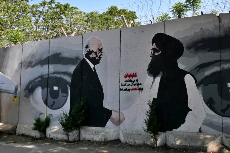 Pictured: An ArtLords mural in Kabul depicting the famous handshake between US Special Representative for Afghanistan Reconciliation Zalmay Khalilzad and Taliban co-founder Mullah Abdul Ghani Baradar following the signing of the US-Taliban agreement in February last year.Photo by Charlie Faulkner April 2021