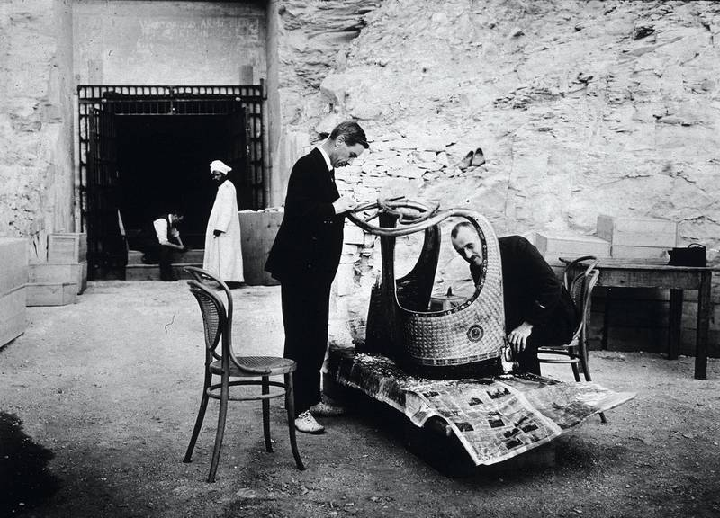 American archaeologist Arthur Mace (1874 - 1928) (left) of the Metropolitan Museum and British chemist Alfred Lucas (1867 - 1945) with the Egyptian government inspect a chariot from the tomb of Pharaoh Tutankhamen, better known as King Tut, Valley of the Kings, Thebes, Egypot, 1923. (Photo by Hulton Archive/Getty Images)
