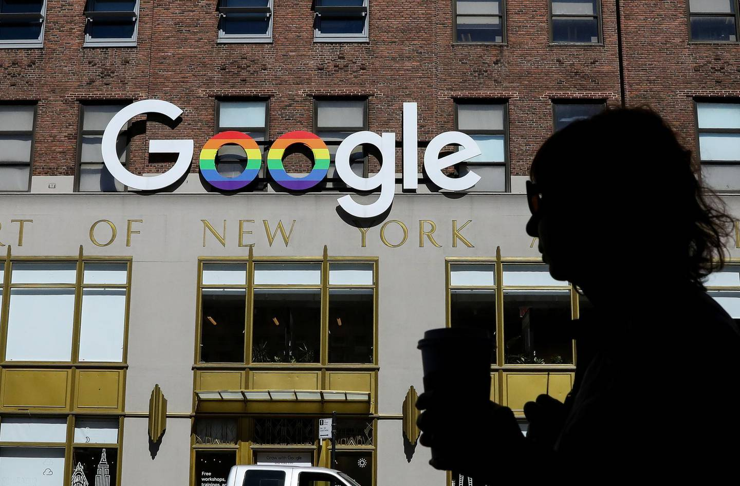 People pass by an entrance to Google offices in New York, U.S., June 4, 2019. REUTERS/Brendan McDermid