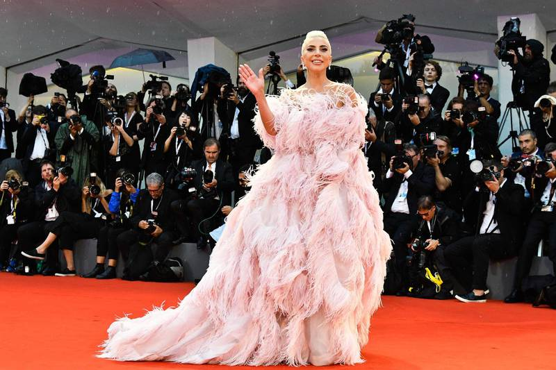 """TOPSHOT - Singer and actress Lady Gaga arrives for the premiere of the film """"A Star is Born"""" presented out of competition on August 31, 2018 during the 75th Venice Film Festival at Venice Lido. (Photo by Vincenzo PINTO / AFP)"""