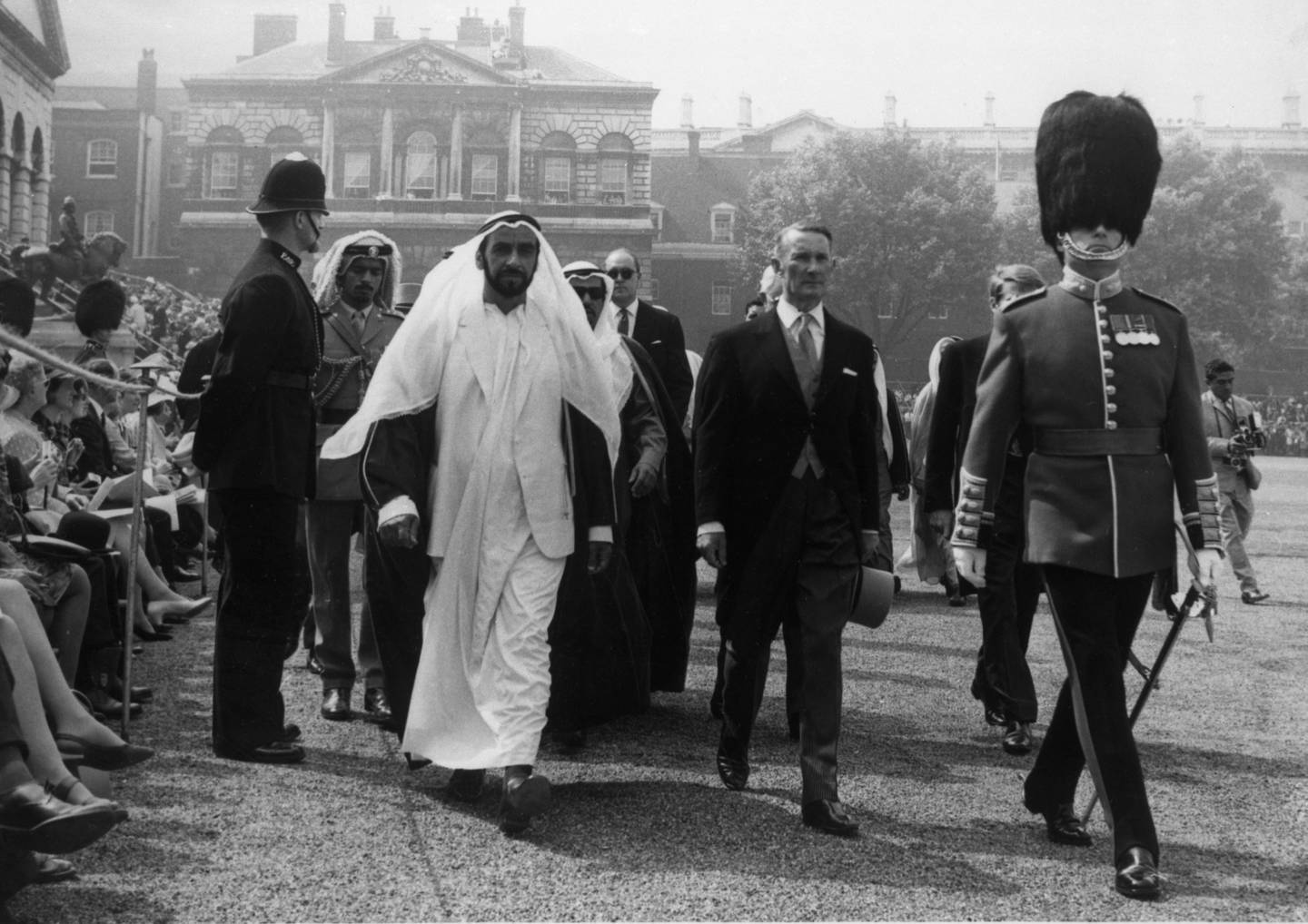 Sheik Khalifa bin Zayed Al Nahyan, President of the United Arab Emirates in Arab dress being escorted to his seat in Horse Guards Parade, London during the Trooping of the Colour Ceremony on June 14, 1969. (AP Photo/Str)