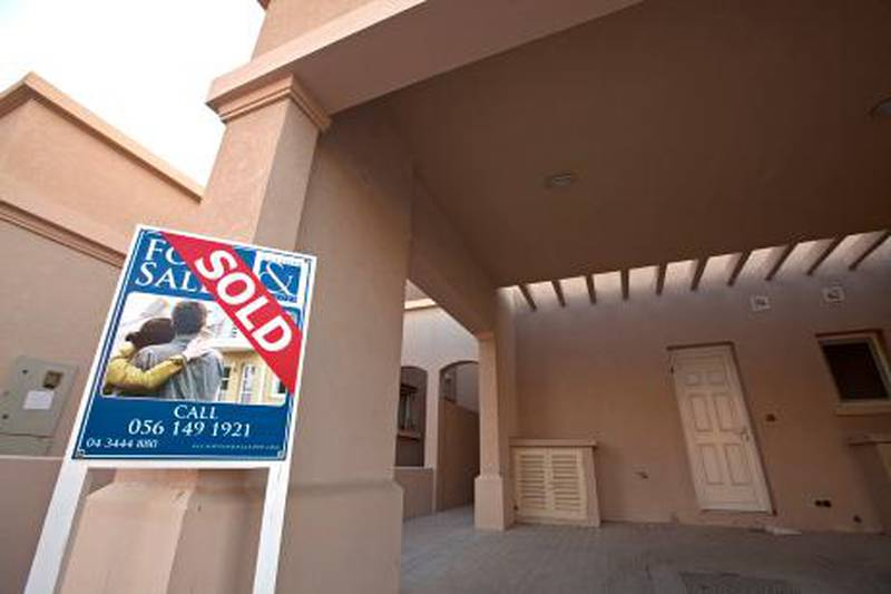 Deira, November 21, 2010 - A sold sign outside a villa in the Springs in Dubai, November 21, 2010. (Jeff Topping/The National) STOCK  property for sale