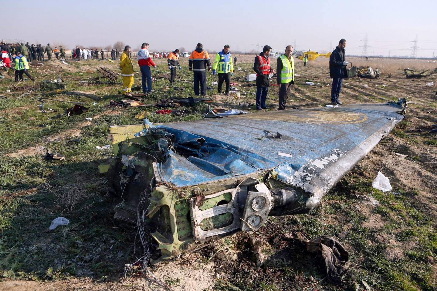 (FILES) In this file photo taken on January 8, 2020 rescue teams are seen at the scene of a Ukrainian airliner that crashed shortly after take-off near Imam Khomeini airport in the Iranian capital Tehran. - Iran said on January 11 that it unintentionally shot down the Ukrainian plane due to 'human error'. (Photo by Akbar TAVAKOLI / IRNA / AFP)
