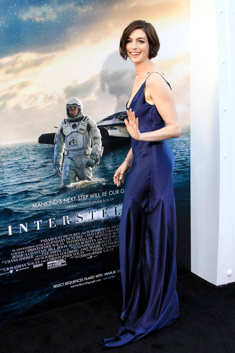 epa04465659 US actress Anne Hathaway arrives for the Los Angeles premiere of 'Interstellar' at the TCL Chinese Theater in Hollywood, Los Angeles, California, USA 26 October 2014. The movie opens in the US on 07 November 2014.  EPA/NINA PROMMER