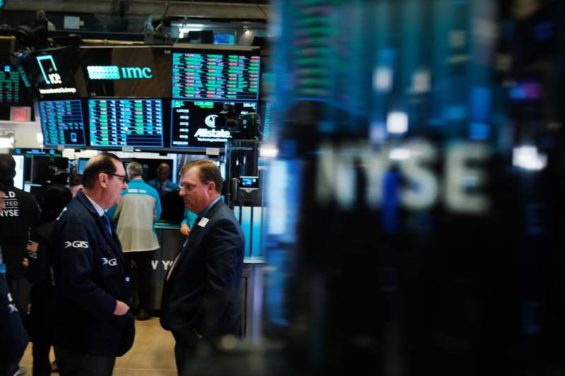 NEW YORK, NEW YORK - NOVEMBER 04: Traders work on the floor of the New York Stock Exchange (NYSE) on November 04, 2019 in New York City. U.S. stocks finished at records highs on Monday with the Dow Jones Industrial Average rising 114 points to close at a record high.   Spencer Platt/Getty Images/AFP == FOR NEWSPAPERS, INTERNET, TELCOS & TELEVISION USE ONLY ==