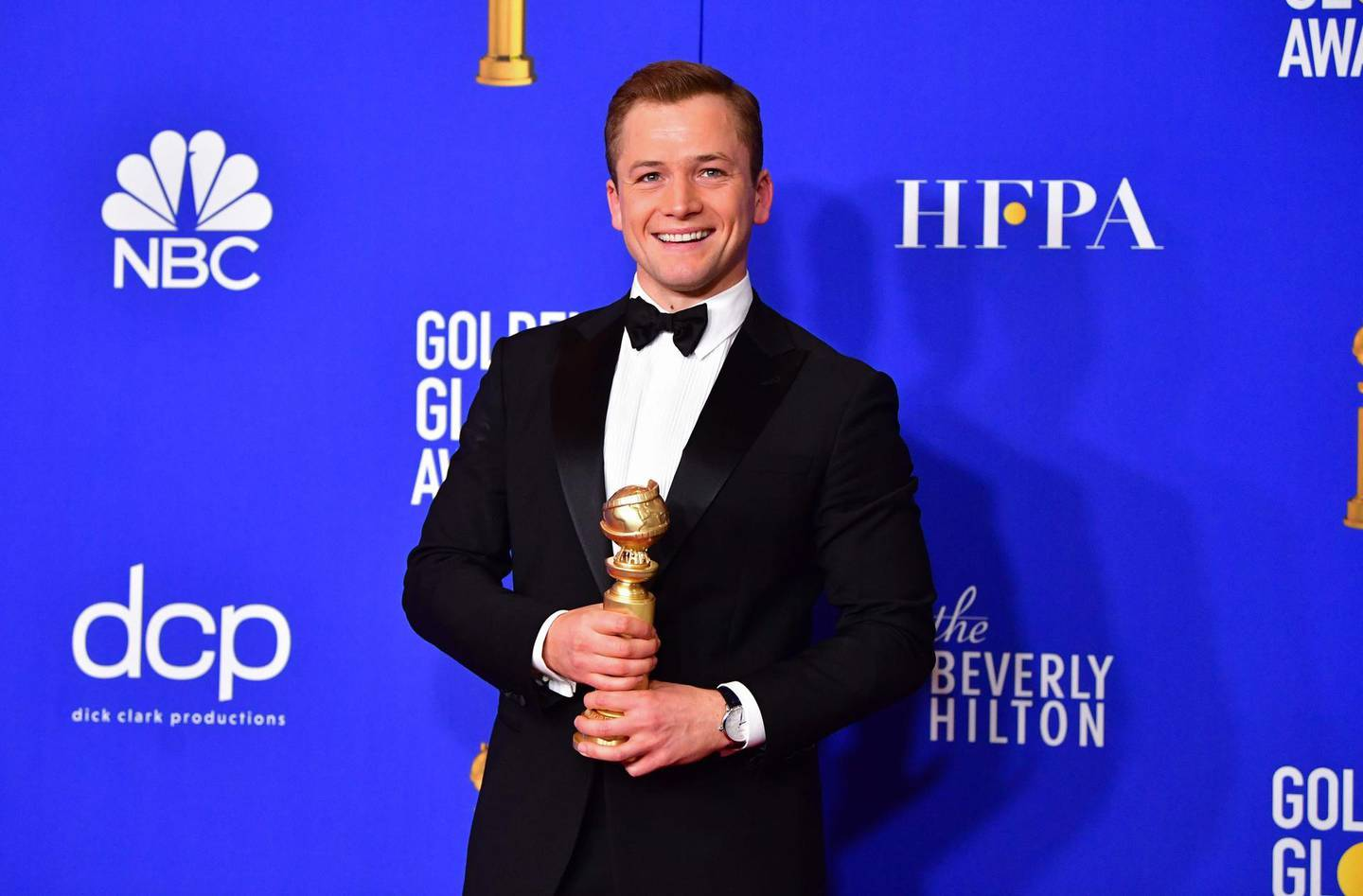 Actor Taron Egerton poses in the press room with the award for best Best Performance by an Actor in a Motion Picture - Musical or Comedy during the 77th annual Golden Globe Awards on January 5, 2020, at The Beverly Hilton hotel in Beverly Hills, California. / AFP / FREDERIC J. BROWN