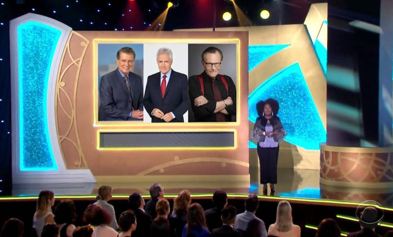 In this video image provided by NATAS and the Daytime Emmys, host Sheryl Underwood introduces a tribute to the late talk show hosts, pictured on screen from left, Regis Philbin, Alex Trebek and Larry King during the 48th Daytime Emmy Awards on Friday, June 25, 2021. (NATAS/Daytime Emmys via AP)