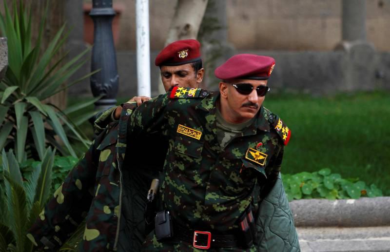 FILE PHOTO: General Tariq Saleh, a nephew of former Yemeni leader Ali Abdullah Saleh, puts on his coat at the Republican Palace in Sanaa, Yemen January 10, 2011. REUTERS/Khaled Abdullah/File Photo