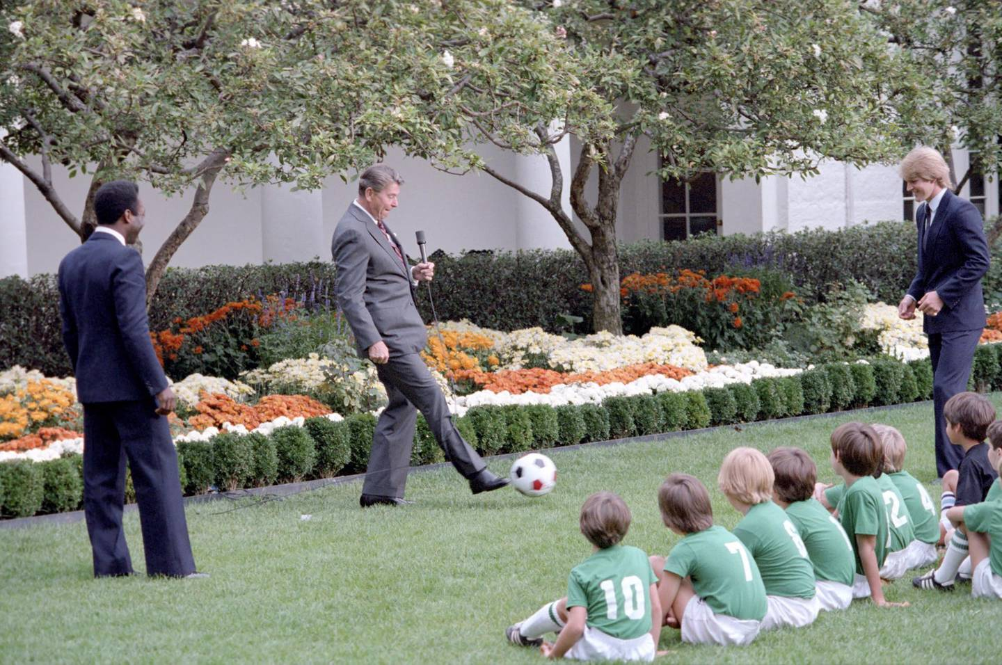 10/14/1982 President Reagan with soccer demonstration with children and Pele and Steve Moyers in the Rose Garden