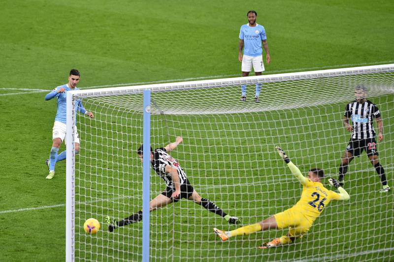 MANCHESTER, ENGLAND - DECEMBER 26: Ferran Torres of Manchester City scores his team's second goal past Karl Darlow of Newcastle United during the Premier League match between Manchester City and Newcastle United at Etihad Stadium on December 26, 2020 in Manchester, England. The match will be played without fans, behind closed doors as a Covid-19 precaution. (Photo by Peter Powell -Pool/Getty Images)