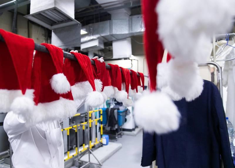 DUBAI, UNITED ARAB EMIRATES. 20 DECEMBER 2020. Santa hats hanging in the laundry facility at Radisson Blu Hotel, Dubai Deira Creek.(Photo: Reem Mohammed/The National)Reporter: Patrick RyanSection: