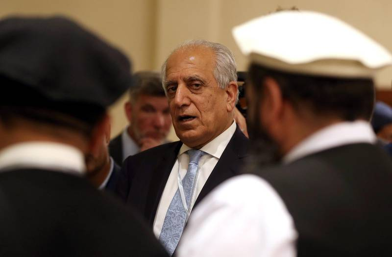 (FILES) In this file photo taken on July 08, 2019 US Special Representative for Afghanistan Reconciliation Zalmay Khalilzad attends the Intra Afghan Dialogue talks in the Qatari capital Doha. The top US negotiator on Afghanistan said Tuesday he was ready to conclude peace talks with the Taliban as he headed back to Qatar on a mission to end America's longest war. / AFP / KARIM JAAFAR