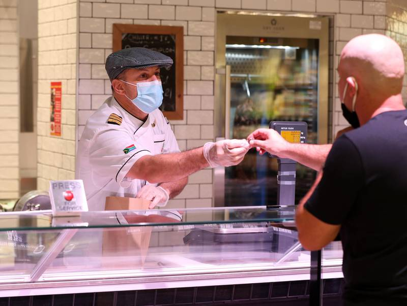 Jerome Stubbs. A group of South African pilots on unpaid leave for more than a year become specialist butchers at the Organic Cafe in Dubai on May 30th, 2021. Chris Whiteoak / The National. Reporter: Kelly Clark for News