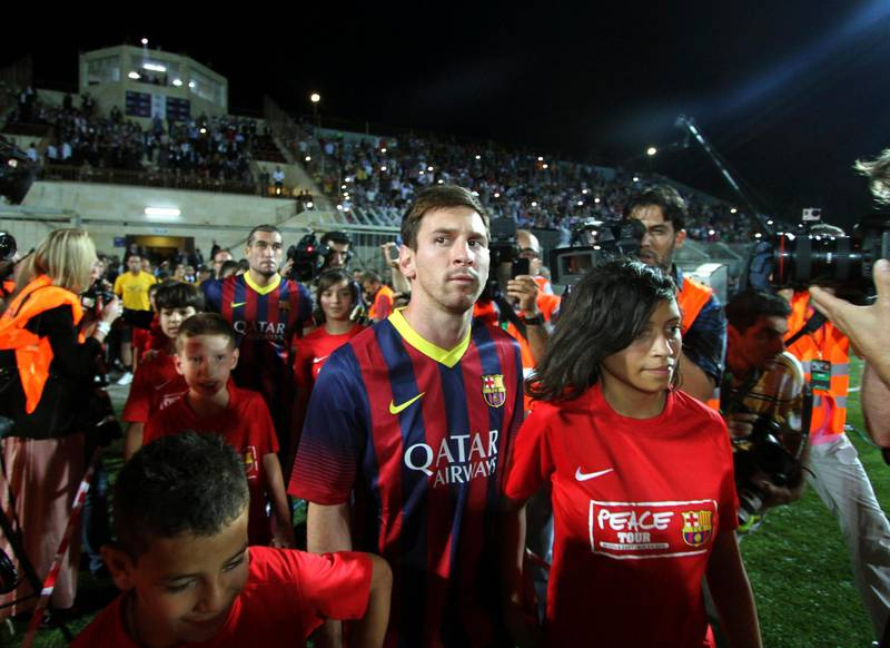 FC Barcelona's Argentine striker Lionel Messi enters a stadium for a football clinic session with Palestinian children in the West Bank city of  Hebron, Saturday, Aug. 3, 2013. The Spanish club arrived in the region Saturday with superstars Messi and Neymar touching down in Tel Aviv. They then headed to Bethlehem, where they visited Jesus' traditional birthplace and met with Palestinian President Mahmoud Abbas. (AP Photo/Nasser Shiyoukhi) *** Local Caption ***  Mideast Palestinians Soccer Barcelona Middle East Trip.JPEG-0986e.jpg