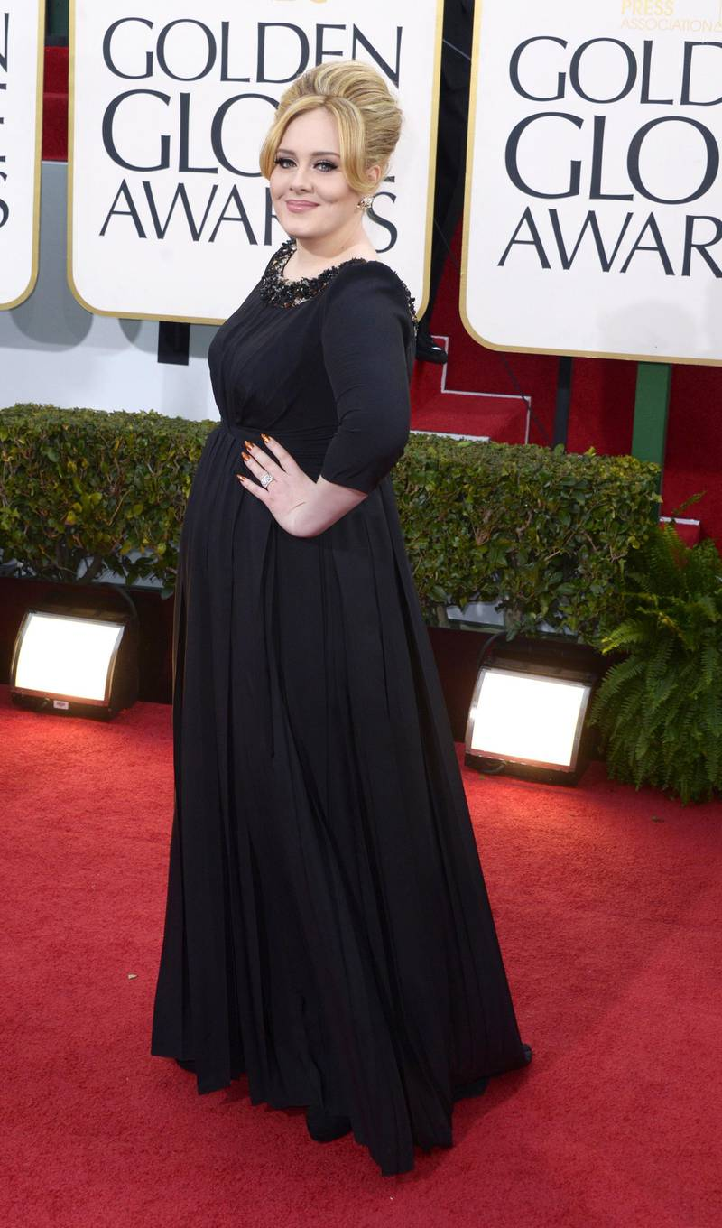epa03534434 British singer Adele arrives for the 70th annual Golden Globe Awards held at the Beverly Hilton Hotel in Beverly Hills, Los Angeles, California, USA, 13 January 2013.  EPA/PAUL BUCK