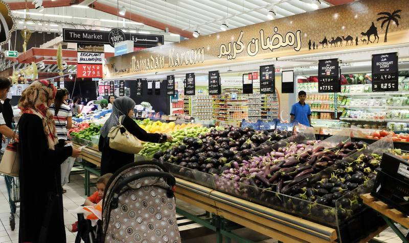 """Dubai, United Arab Emirates, Jun 18, 2014 -  Customers at the vegetables section with a banner that says """" Ramadan Kareen"""" inside the Geant supermarket at Ibn Batuuta Mall. ( Jaime Puebla / The National Newspaper )"""