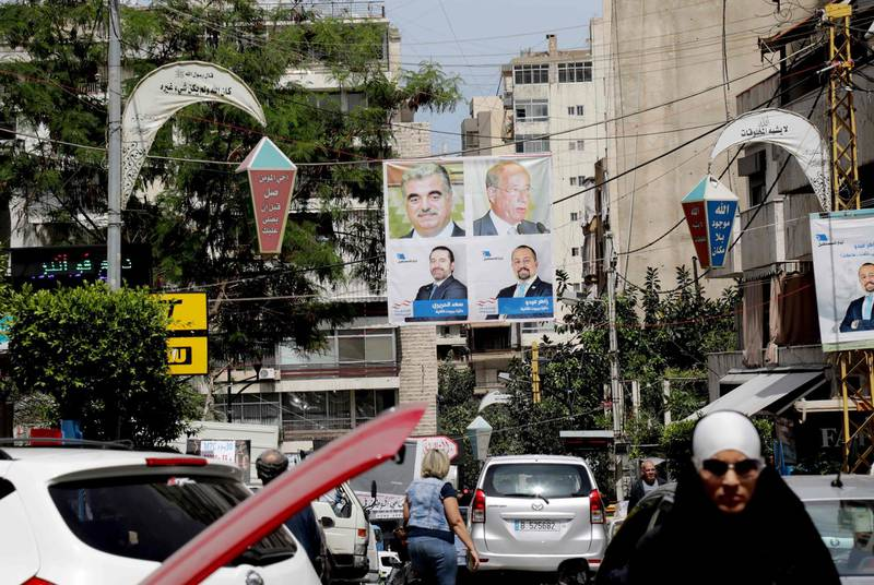 A picture taken on April 3, 2018 shows campaign poster for Lebanese Prime Minister Saad Hariri, for the upcoming Lebanese parliamentary election, hanging in the Tariq Jedideh district of Beirut. As its first parliamentary vote in nearly a decade nears, Lebanon has been swept into campaign fever: posters on every corner, televised debates, and neighbours bickering over new electoral procedures. / AFP PHOTO / AFP- / Anwar AMRO