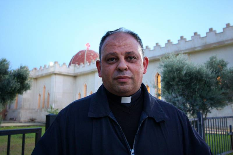 IRAQ-MOSUL_S TWO GOVERNORS-PICTURED-Father Thaabit standing outside Mar Giwargis Monastery in Assyrian town Karemlash which was liberated from ISIS in October 2016. Charlie Faulkner for The National